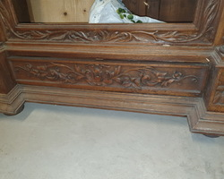 Norman bonnet in richly carved oak early 20th century