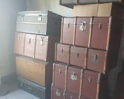 Old trunks and canteens of different sizes and colors