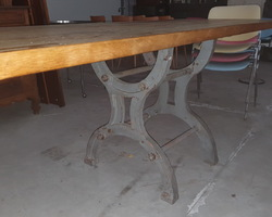 Industrial table made from a machine base and a monastery table top