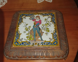 Wood and earthenware trivet from the early 20th century