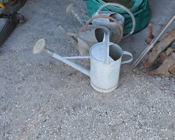two old zinc watering cans