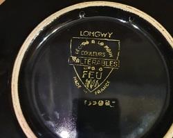 Longwy dish on a black background