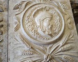 Pair molding resin panels with Greek warriors